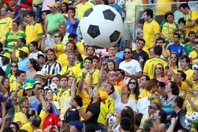 Aficionados disfrutan de un partido de la reciente Copa de Confederaciones de Brasil.